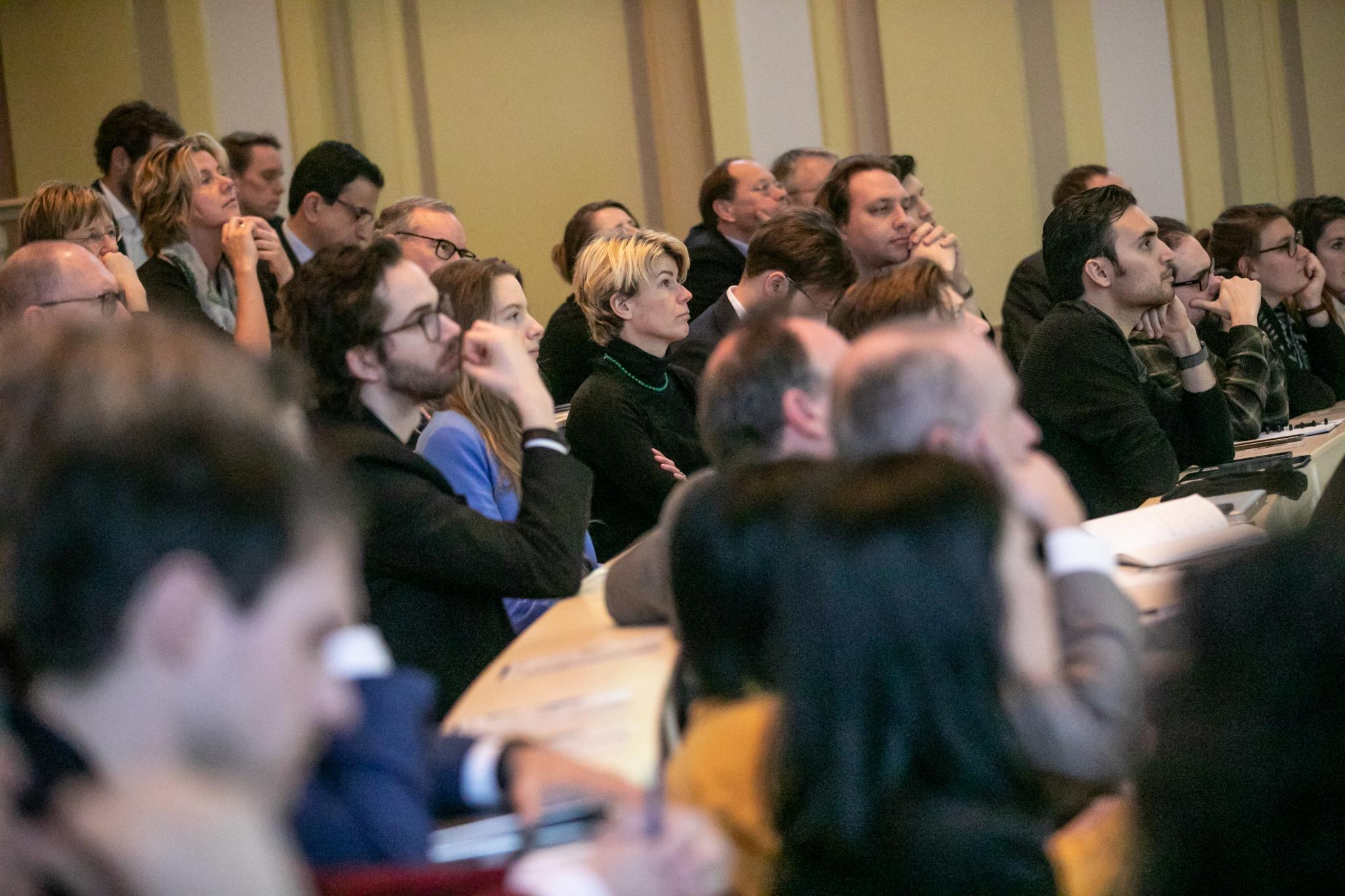 Audience at BOLD Cities kick-off, listening to Peter Swire.