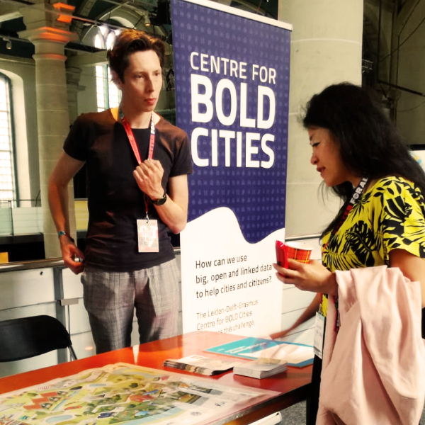 The BOLD Cities team explains its research game at the Cities for Digital Rights conference.